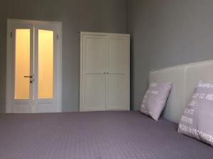 Letto o letti in una camera di Garibaldi 1
