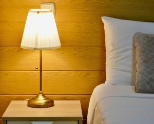 A bed or beds in a room at Apartamentos Champs-Élysées