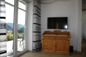 A television and/or entertainment center at Haus Bergfrieden