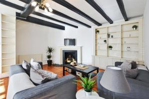 Coin salon dans l'établissement Luxury 3 bedrooms Mews House in South Kensington