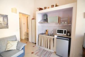 A kitchen or kitchenette at Residence Noto Nobilis