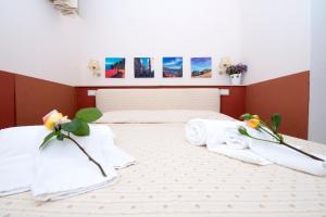 A bed or beds in a room at Residence Noto Nobilis