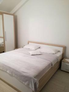 A bed or beds in a room at Apartment Rina
