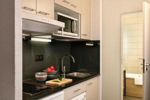 Cuisine ou kitchenette dans l'établissement Citadines Kléber Strasbourg