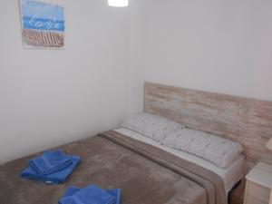 A bed or beds in a room at Apartamento a la Playa