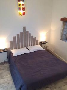 Posteľ alebo postele v izbe v ubytovaní Le gite de l'ecole