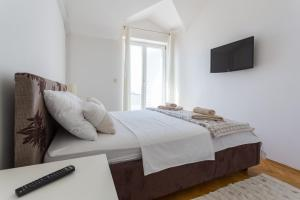 A bed or beds in a room at Villa Iva