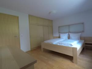 A bed or beds in a room at Bizau 361