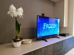 A television and/or entertainment center at Casa Relax