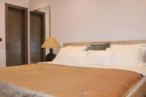 A bed or beds in a room at Aless Luxury Apartment