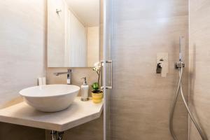 A bathroom at Panos Luxury Studios