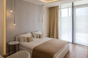 A bed or beds in a room at Zala Springs Golf Resort