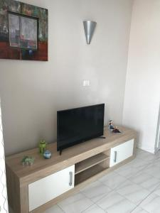 A television and/or entertainment center at Royale apartaments los cristianos
