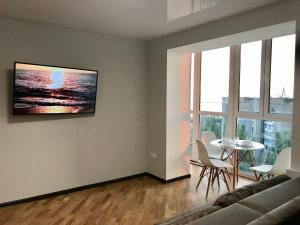 A television and/or entertainment center at Central Apartment Sea View