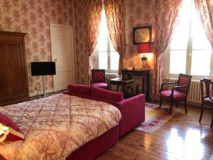 Un ou plusieurs lits dans un hébergement de l'établissement Les chambres d'Hotes du Domaine du Pacha
