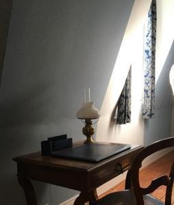 Coin salon dans l'établissement Les chambres d'Hotes du Domaine du Pacha