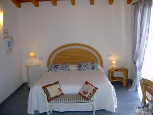 A bed or beds in a room at Casa Lorenza