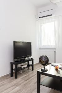 A television and/or entertainment center at Calea Victoriei Residence