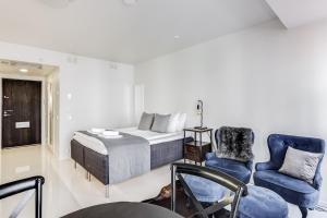 Vuode tai vuoteita majoituspaikassa Helsinki Homes Apartments