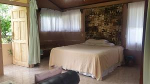 A bed or beds in a room at Quijote Experience
