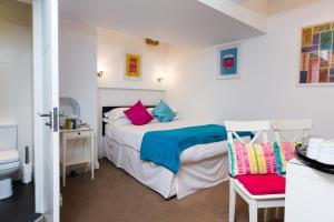 Un ou plusieurs lits dans un hébergement de l'établissement The Pods at Nell Gwynn