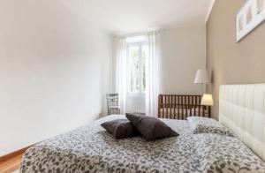 Uma cama ou camas num quarto em Appartamento Marmorata