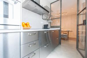 A kitchen or kitchenette at Atocha Madrid Center Apartment