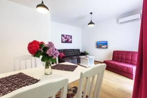 A seating area at Apartments Royal Lux