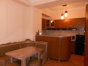 A kitchen or kitchenette at Ucha's Apartment