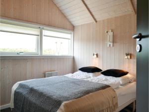 A bed or beds in a room at Holiday home P. Chr. Dahls Vej Hvide Sande X