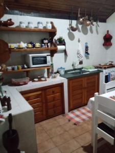 Cuina o zona de cuina de Chalé Luar da Montanha