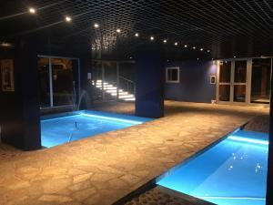The swimming pool at or near Large studio eiffel tower