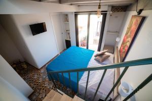 Postel nebo postele na pokoji v ubytování Le Terme Romane Apartments