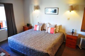 A bed or beds in a room at St James Apartments