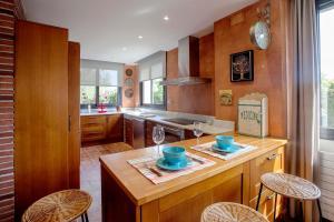 A kitchen or kitchenette at Villa Alexa