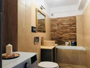A bathroom at Modern and Cozy Apartment Cluj