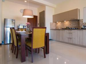 A kitchen or kitchenette at Rococo Residence