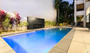 The swimming pool at or near Cairns City Apartments