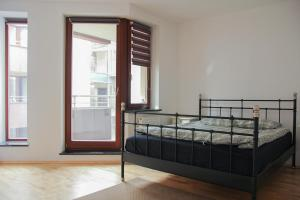A bed or beds in a room at Just in Center apartment