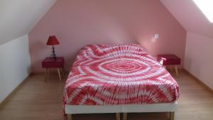 Un ou plusieurs lits dans un hébergement de l'établissement Gite de la forêt