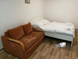 A bed or beds in a room at Apartments Jelka
