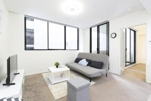 A seating area at Cozy apartment in Parramatta CBD