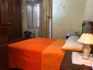 A bed or beds in a room at House Il Parco