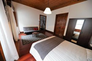 A bed or beds in a room at Angra Downtown Flat