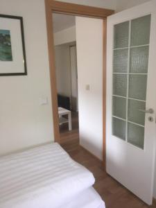 A bed or beds in a room at Apartment Erna
