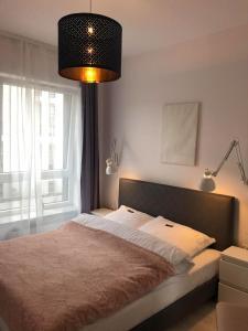 A bed or beds in a room at Apartament 222 Apartamenty No.1