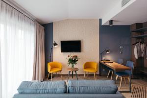 Telewizja i/lub zestaw kina domowego w obiekcie Avena by Artery Hotels