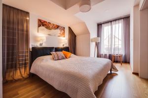 Ein Bett oder Betten in einem Zimmer der Unterkunft AMAVI Mostecka Apartments