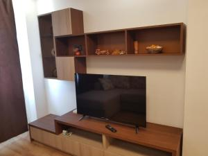 A television and/or entertainment center at Central Luxury Apartment