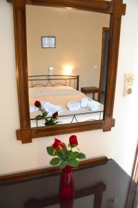 A bed or beds in a room at Voula Apartments